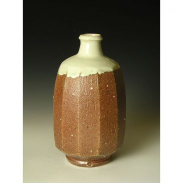 PR372  A wood fired faceted bottle.