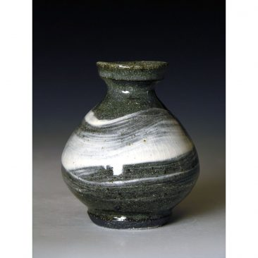PR390   A small bottle or vase with Hakeme.