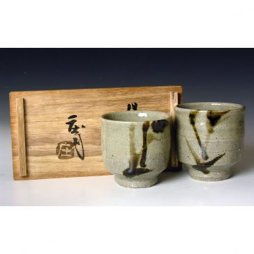 HJ61  A Pair of 'His and Hers' Yunomi by Hamada Shoji.